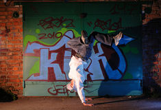 Hip-hop dancer. Against wall with graffiti stock photo