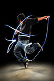 Hip Hop Dancer. Performing with LED lights dancing over dark background with spotlight royalty free stock image