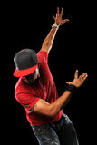 Hip Hop Dancer. African American hip hop dancer performing isolated over black background royalty free stock photography