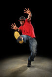 Hip Hop Dancer. African American hip hop dancer performing over dark background with spotlight stock photos