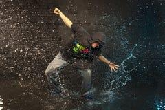 Hip hop dancer. Street dancer in aqua studio stock photo