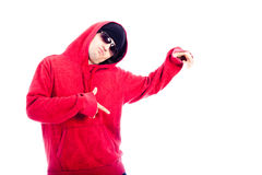 Hip Hop dancer. In red hoodie pointing, isolated on white background Royalty Free Stock Photo