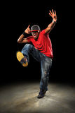 Hip Hop Dancer. African American hip hop dancer performing over dark background with spotlight royalty free stock photo