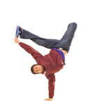 Hip-hop dancer. Standing in freeze on white background royalty free stock image