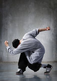 Hip-hop dancer. Cool looking hip-hop dancer posing on old wall stock image