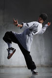 Hip-hop dancer. Cool looking hip-hop dancer posing on old wall stock photography