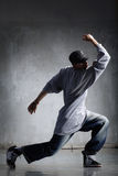Hip-hop dancer. Cool looking hip-hop dancer posing on old wall stock photos