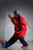 Hip-hop dancer. Cool looking hip-hop dancer posing on old wall stock images