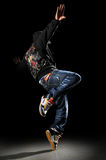 Hip Hop Dancer. Performing over a black background royalty free stock photography