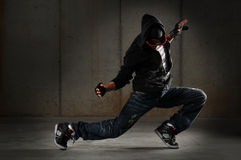 Hip hop dancer. Performing against a grunge wall stock photos