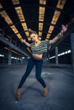 Hip hop dancer in an abandoned industrial hall Royalty Free Stock Image