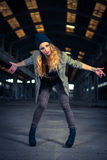 Hip hop dancer in an abandoned industrial hall Stock Image