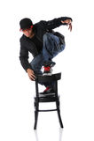 Hip Hop Dancer on Chair Stock Images
