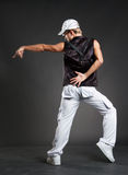 Hip-hop dancer in dance pointing Royalty Free Stock Photography