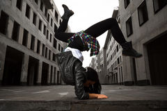 Hip-hop dancer girl posing on the deserted streets. A hip-hop dancer girl posing on the deserted streets Stock Photos
