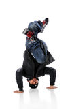Hip Hop Dancer On Head Stand. African American hip hop dancer performing a head stand stock photos