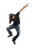 Hip Hop dancer Jumping. Hip Hop dancer wearing a hat and jumping isolated on a white background stock photography