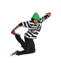 Hip Hop Dancer Jumping. African American hip hop dancer jumping isolated over white background Royalty Free Stock Photo