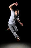 Hip Hop Dancer Jumping. Over a dark background royalty free stock photo