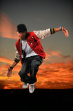 Hip Hop Dancer Jumping. African American hip hop dancer jumping with sunset background stock image