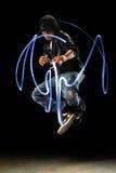Hip Hop Dancer with LED Lights. African American hip hop dancer with LED lights over dark background royalty free stock image