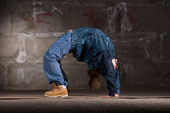 Hip hop dancer in modern style over brick wall Royalty Free Stock Photography