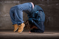 Hip hop dancer in modern style over brick wall Royalty Free Stock Photos