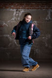 Hip hop dancer in modern style over brick wall Royalty Free Stock Photo