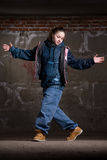 Hip hop dancer in modern style over brick wall Royalty Free Stock Images