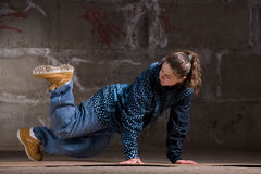 Hip hop dancer in modern style over brick wall Stock Images