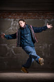 Hip hop dancer in modern style over brick wall Stock Image
