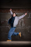 Hip hop dancer in modern style over brick wall Stock Photos
