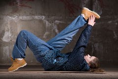 Hip hop dancer in modern style over brick wall Stock Photography