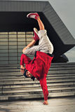 Hip Hop dancer one hand stand Stock Images
