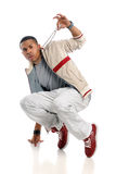 Hip Hop Dancer Performing. Young African American hip hop dancer performing isolated over white background Stock Photography