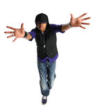 Hip Hop Dancer Performing. African American hip hop dancer performing over dark background with spotlight Stock Images