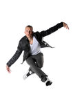Hip Hop Dancer Performing. Young hip hop dancer jumping isolated over white background Royalty Free Stock Images