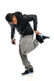 Hip Hop Dancer Performing. Portrait of African American hip hop dancer isolated over white background Stock Image