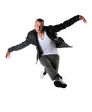 Hip Hop Dancer Performing. Young hip hop dancer performing a jump isolated over a white background Royalty Free Stock Photos