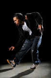 Hip Hop Dancer Performing. African American hip hop dancer performing over a dark background Royalty Free Stock Photo