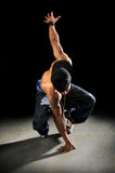 Hip Hop Dancer Performing. African American hip hop dancer performing over a dark background Stock Images