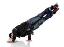 Hip Hop Dancer Performing. African American hip hop dancer performing a side hand and head stand Royalty Free Stock Photo