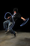 Hip Hop Dancer Performing. African American hip hop dancer with LED lights over dark background Royalty Free Stock Photography