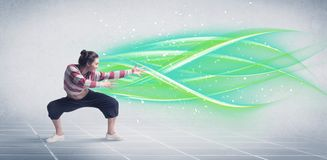 Hip hop dancer posing with green lines stock photos