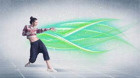 Hip hop dancer posing with green lines royalty free stock photo