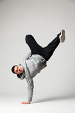 Hip-hop dancer standing on one hand Stock Image