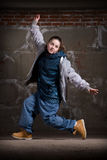 Hip hop dancer in style over brick wall Royalty Free Stock Image