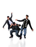 Hip Hop Dancers Performing. Three young men dancing hip hop moves Royalty Free Stock Image