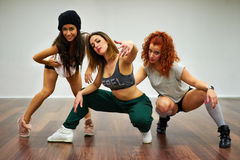 Hip Hop Dancing Girls. Hip hop girls posing in dancing school royalty free stock image