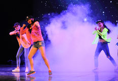 Hip hop dancing in the smoke-The campus dance Royalty Free Stock Photography